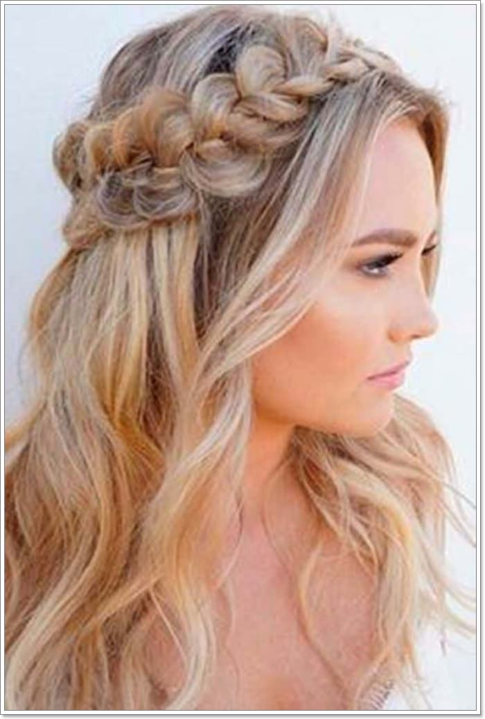 1383226c8cc Get that boho chic style with a halo of very lose and messy braids…