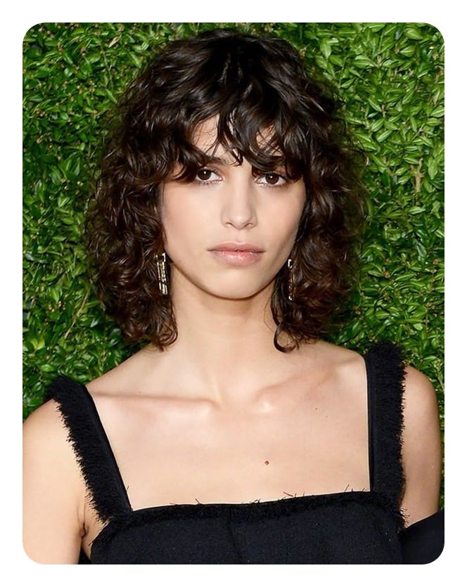 ... make sure that you get a hairstyle that works well for you and doesn't make your curls all messed up. The bangs with waves are a bold choice for sure.
