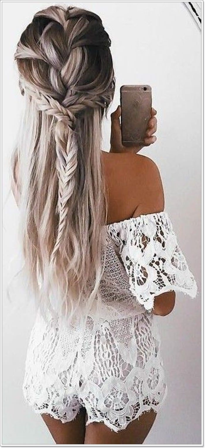 b4d85b021a1 A big mess bun holds the braids in place and adds shape to the style. The  underlying dark shades with the highlighted colors also make the style to  pop in ...