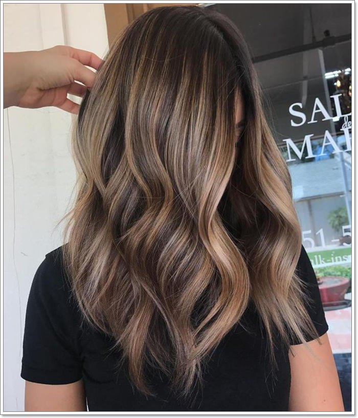 You can try this popping ash brown highlight for an exhilarating take on your short dark brown hair. It will definitely flatter you all the ways possible.